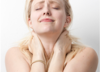 lady holding neck with hands due to neck pain